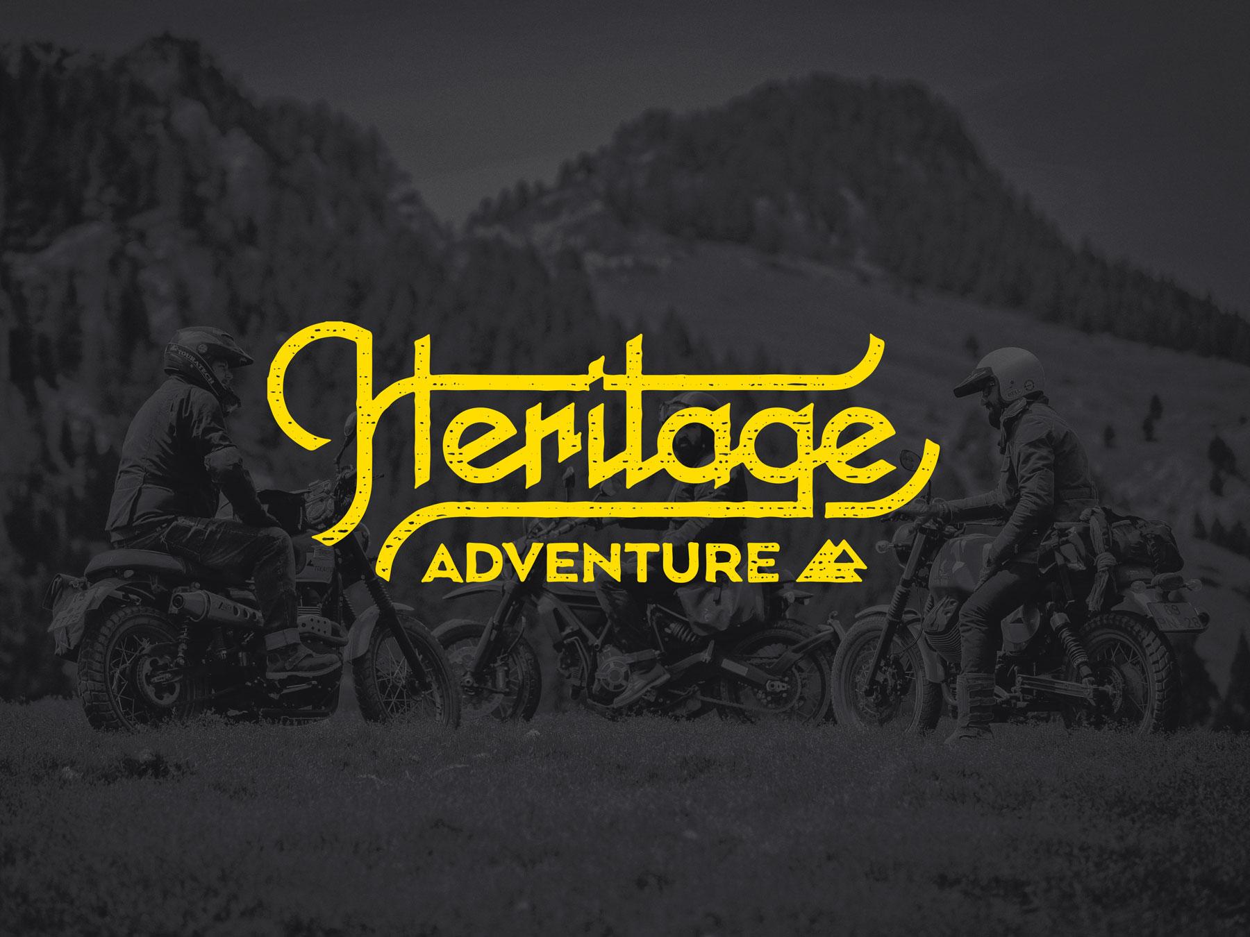Man sieht das Logo von Heritage Adventure von TOURATECH. Die gelbe Schrift steht vor dunklem Hintergrund, in dem eine Gruppe Motorradfahrer im Gebirge zu erkennen ist. Das Corporate Design ist von MAJORMAJOR.